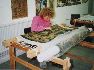 Annabel Wylie working on a carpet