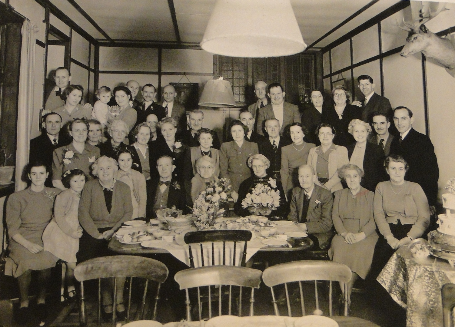 Some Knole staff and their families at a wedding anniversary party in the Buck's Head, Godden Green, in the 1940s