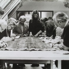 Conserving the Cloth of Gold King's Bed textiles, led by conservator Philippa Lawrence (centre)