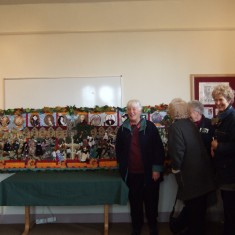 Some of the 55 volunteers seeing the finished tapestry for the first time after two years of individual and group work
