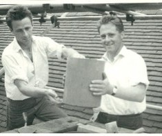 Brothers Alan and Arthur Grubb at work on the rooftops of Knole in the middle of the 20th century