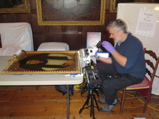 Ian Tyers conducting dendrochronology tests on some early 17th century portraits in Knole's Brown Gallery