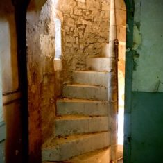 The stone spiral stairs up to Eddy's Music Room
