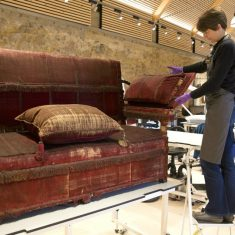 Heather Porter, upholstery conservator, at work on the iconic Knole Sofa