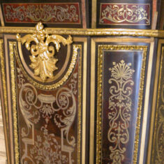 Before conservation treatment, detail of the pedestal incorporating Boulle marquetry.  | NT/Jane Mucklow